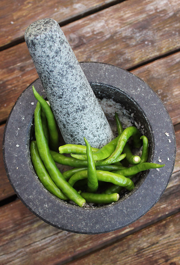 thai birds eye chillies in pestle and mortar