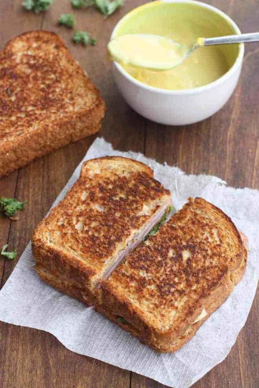 The ultimate grilled ham and cheese sandwich dipped in an easy homemade honey mustard sauce. | Tastes Better From Scratch