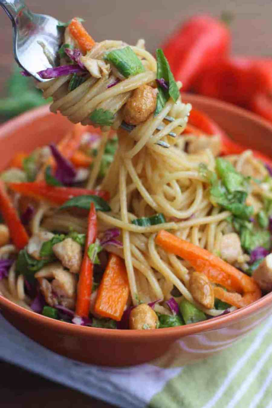 Better than take-out Thai Peanut Chicken Pasta - The perfect easy dinner recipe that's bursting with flavor and uses simple pantry ingredients with sautéed veggies, chicken and a creamy thai peanut sauce. | Tastes Better From Scratch