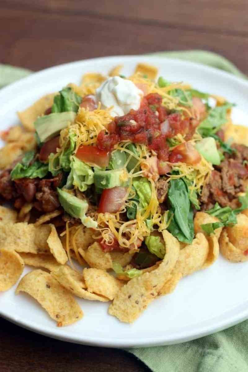 Fritos Taco Salad is a fun and kid-approved easy dinner the entire family will love. Made with real ingredients and ready in less than 30 minutes!   Tastes Better From Scratch