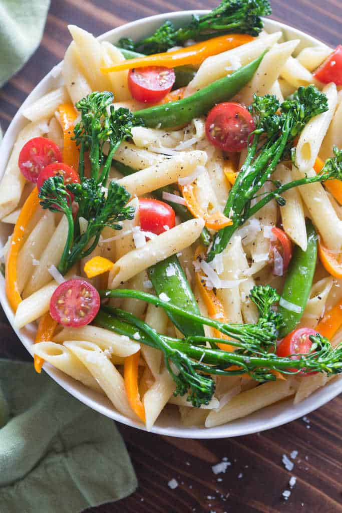 """Pasta Primavera or """"spring pasta"""" is the perfect easy dinner recipe that's healthy too! With a creamy parmesan sauce, penne pasta and fresh vegetables this dinner is a winner! tastesbetterfromscratch.com"""