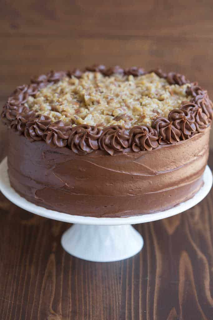 The BEST German Chocolate Cake! Layers of coconut and chocolate frosting and an amazing, easy homemade chocolate cake. | tastesbetterfromscratch.com