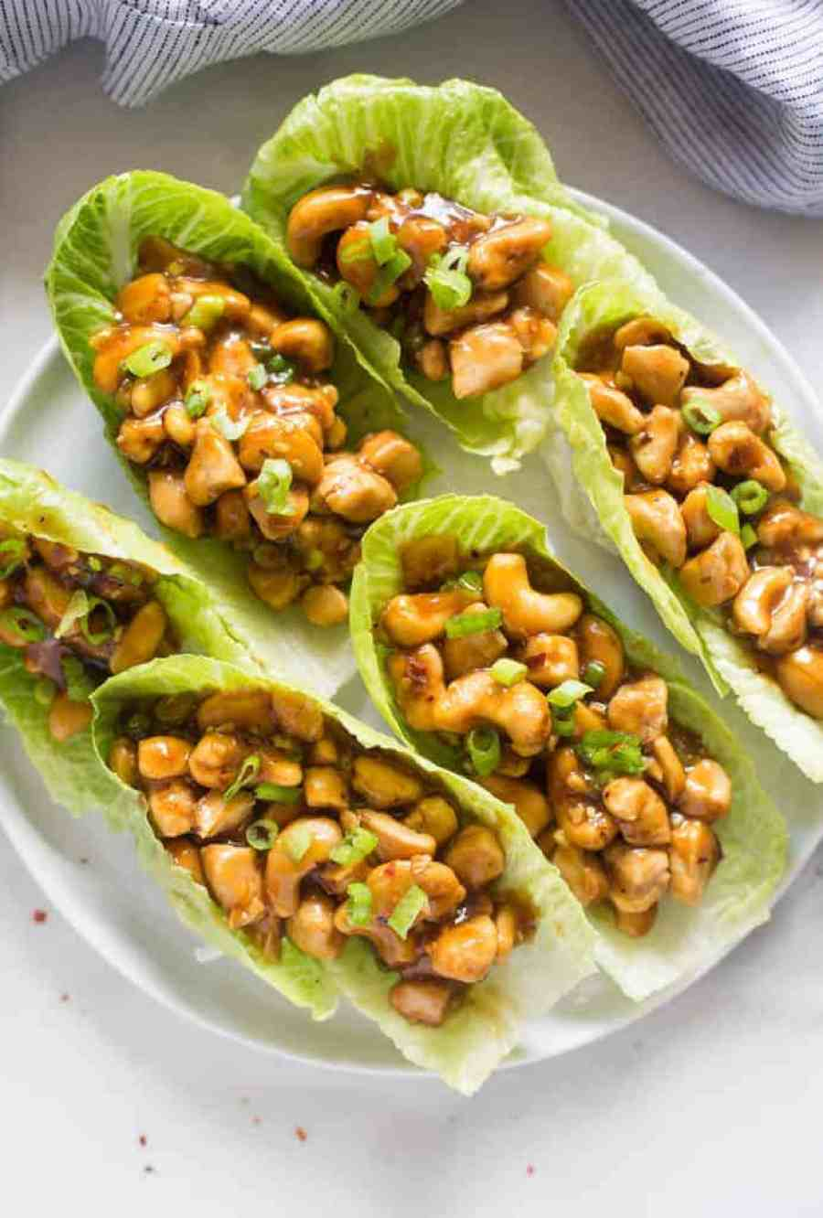 Delicious, easy and bursting with flavor--there's so much to love about these Cashew Chicken Lettuce Wraps! Serve them as a main dish or appetizer. | tastesbetterfromscratch.com