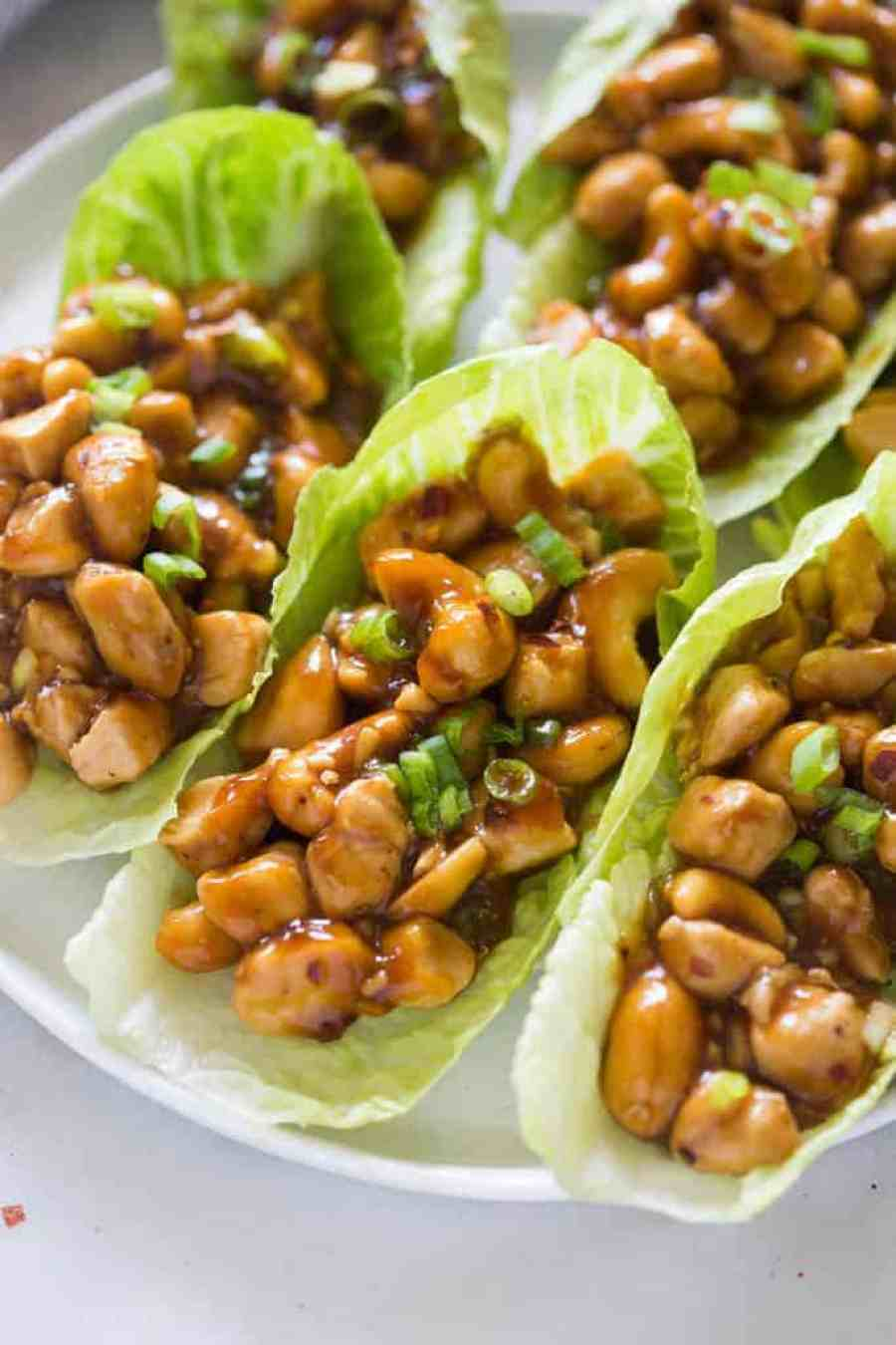 Cashew Chicken Lettuce Wraps that are better-than-take-out and made from scratch in less than 30 minutes! Grilled chicken smothered in the tastiest general-tso-inspired sauce with crunchy cashews, spooned into a crisp green lettuce cup. | tastesbetterfromscratch.com
