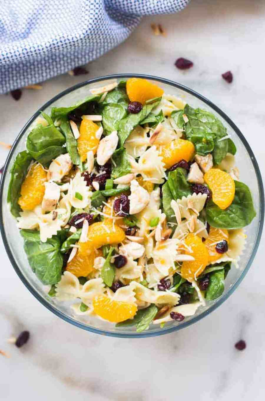 I could eat a big bowl of this hearty and Healthy Chicken Pasta Salad every single day! Spinach, chicken, almonds, mandarin oranges, craisins and parmesan cheese tossed together in a light and creamy citrus dressing.   tastesbetterfromscratch.com