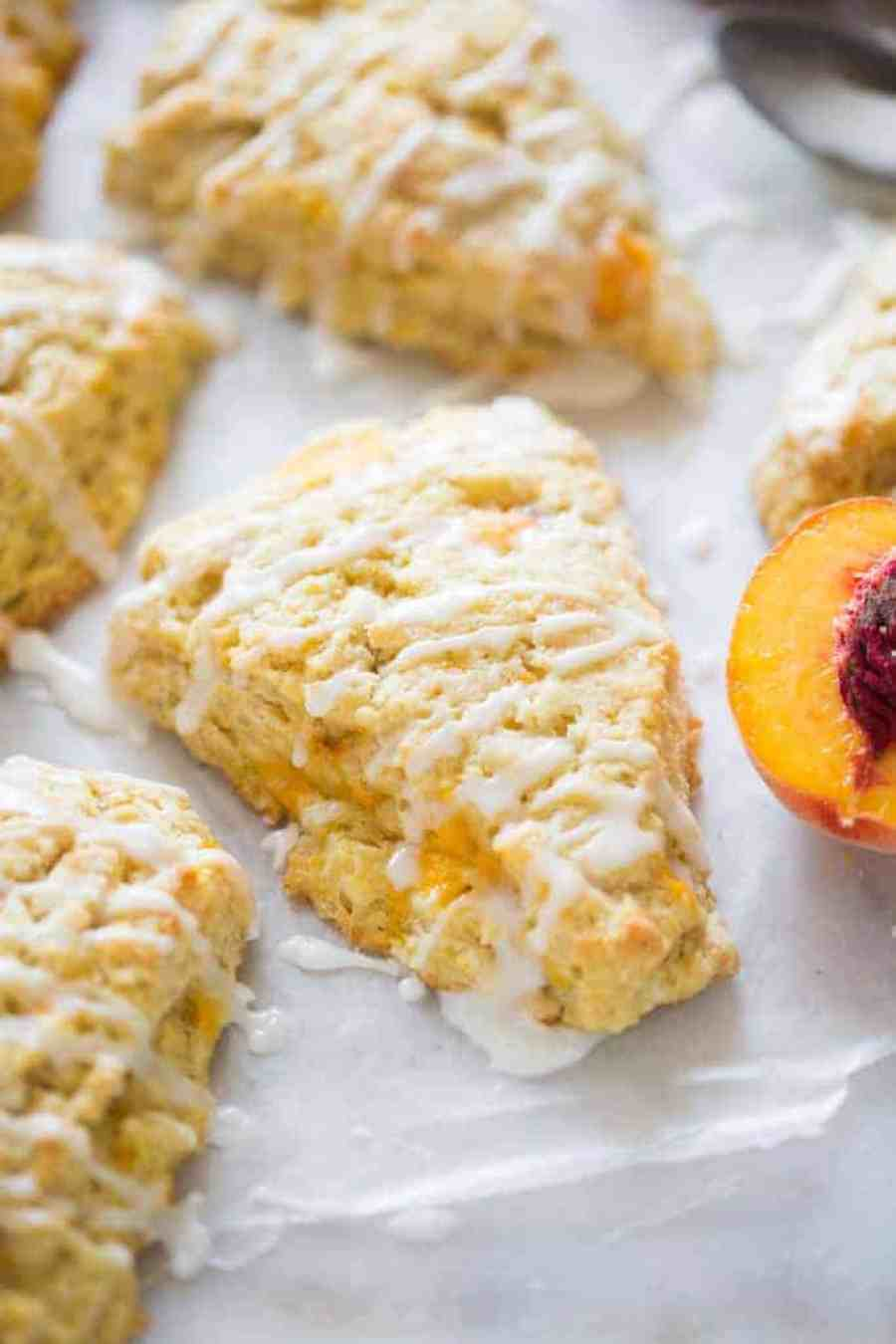 Flakey, tender fresh peach scones make the perfect small baked treat for brunch. Perfect recipe for using fresh peaches.   tastesbetterfromscratch.com