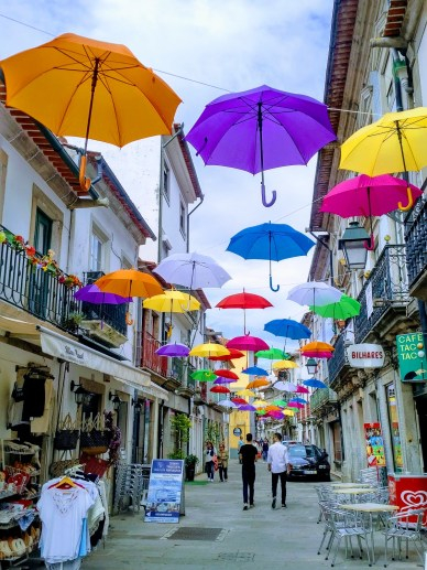 This shopping street in Vila de Castello was hung with gaudy and highly effective umbrellas