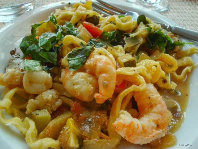 Pasta Puttanesca with shrimp, local vegetables, homemade noodles