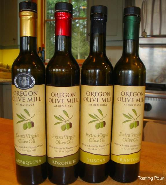 Bottle shots of Arbequina, Koroneiki, Tuscan, and Frantoio olive oils at Oregon Olive Mill at Red Ridge Farms