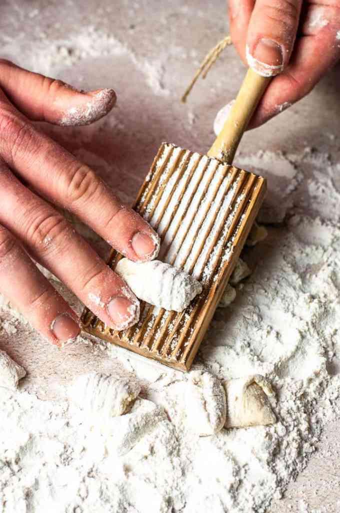 hand rolling homemade gnocchi