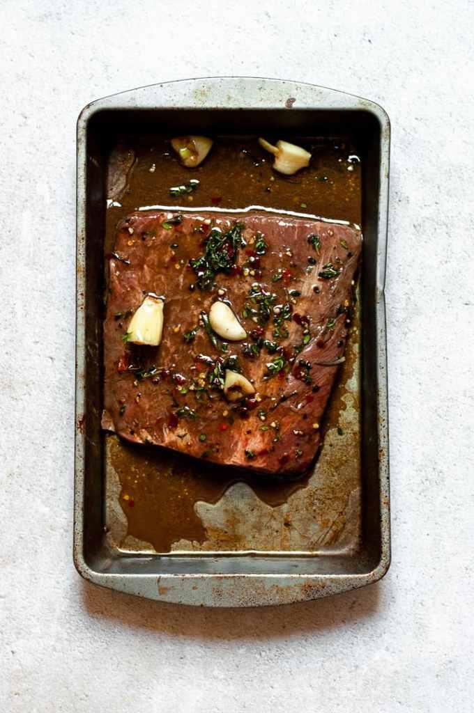 Marinated skirt steak in a dish