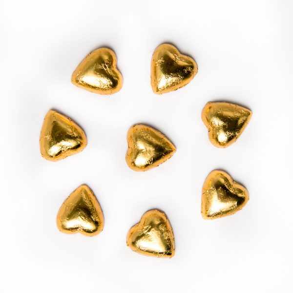 8 gold foil wrapped milk chocolate hearts.