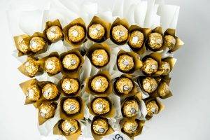 31 individually wrapped Ferrero Rocher chocolates surrounded by white cello in a large gold box.