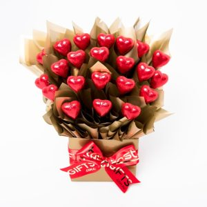 22 red foil wrapped milk chocolate hearts surrounded by gold cello in a small gold box.
