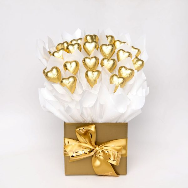 22 gold foil wrapped milk chocolate hearts surrounded by white cello in a small gold box.