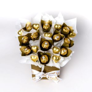 """11 Ferrero Rocher chocolates """"leafed"""" in gold cello and 9 gold foil wrapped milk chocolate hearts surrounded by white cello in a small gold box."""