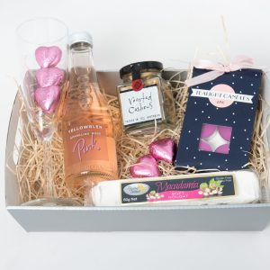 This hamper consists of the following: 1 x Yellowglen Pink Piccolo 1 x Champagne glass 1 x 60g Ogilvie & Co. roasted nuts 1 x 60g Flying Swan nougat 1 x 6 Pack scented tealight candles 5 x Pink milk chocolate hearts