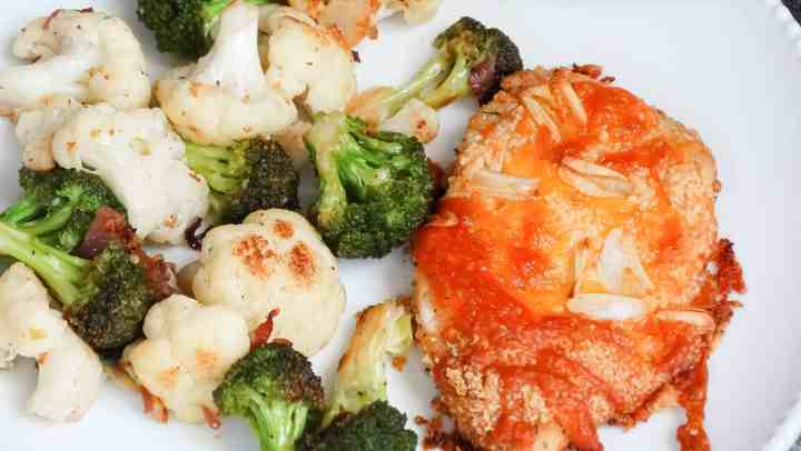 """alt=""""garlic cheddar chicken served with roasted broccoli and cauliflower on a white serving plate"""""""