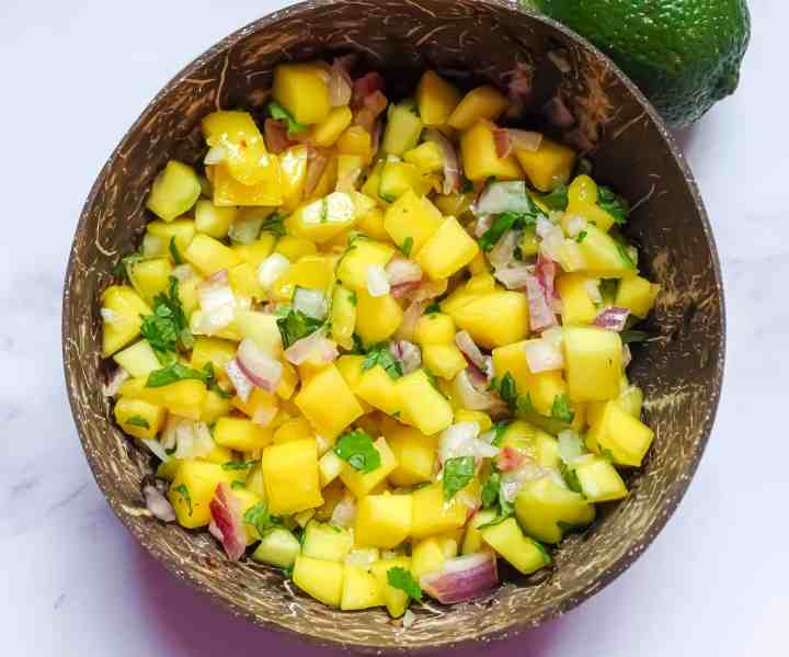 easy mango salsa in a coconut bowl