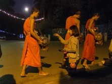 Buddhist alms giving ceremony.