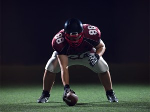 football player preparing for snap