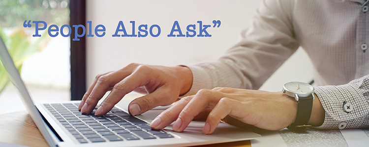 man typing on laptop using People Also Ask
