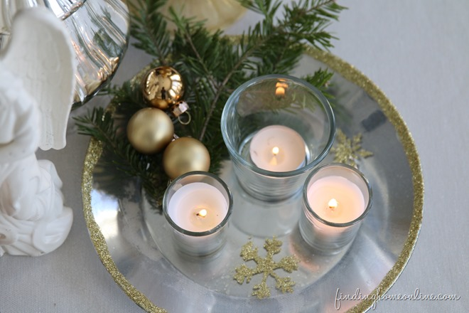 silver and gold candle plate