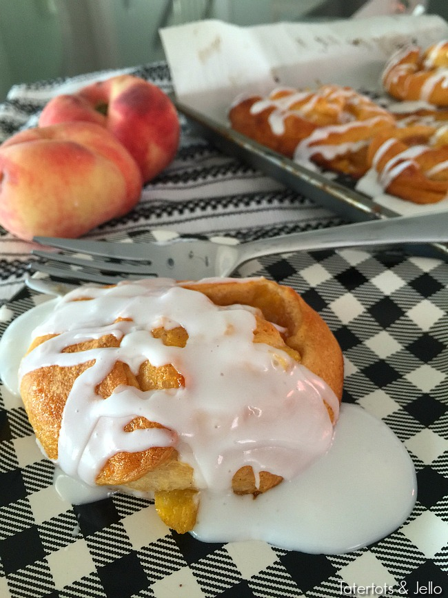peach cinnamon rolls with glaze