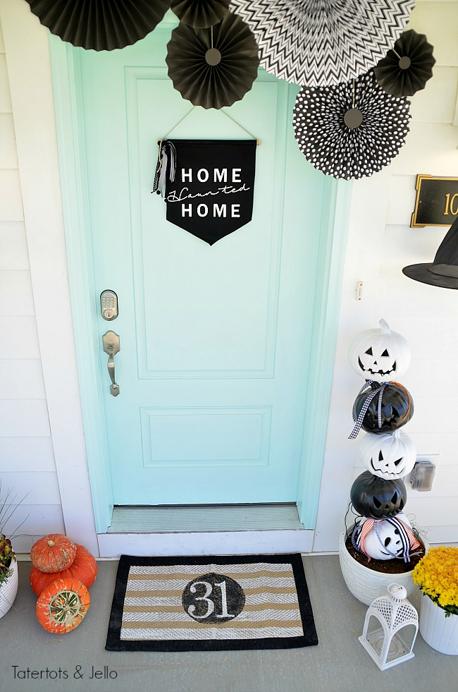 halloween porch pennant medallions. Create a witch theme for your halloween home decor this year with a DIY sign, hanging hats and other spooky ideas!