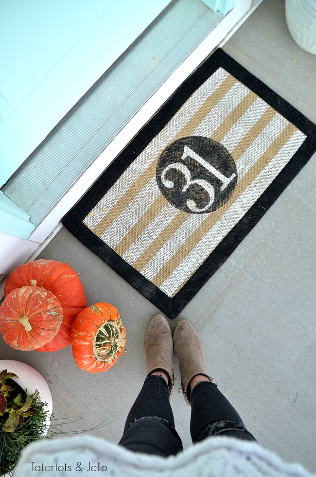 halloween porch stencilled rug. Create a witch theme for your halloween home decor this year with a DIY sign, hanging hats and other spooky ideas!