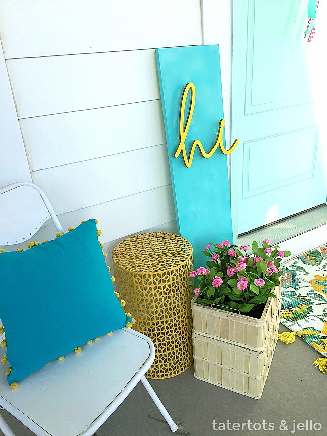 DIY 3-Dimensional Spring Sign. Make a bright and happy spring sign for your porch.