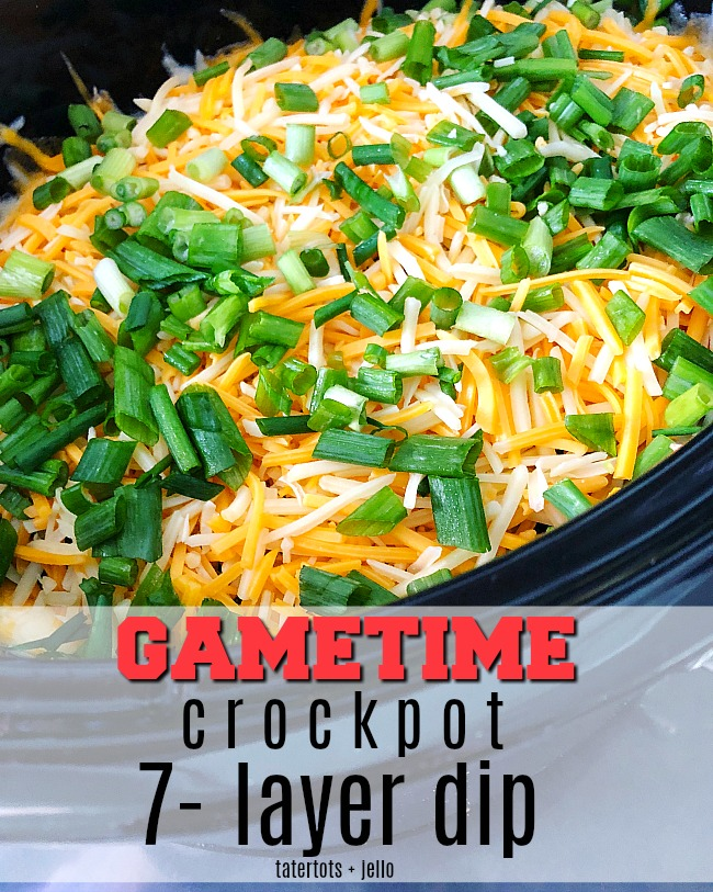Game Day Warm Crock-pot 7-layer dip - all of the delicious layers blend together in your Crock-pot to create the PERFECT hot dip to serve!