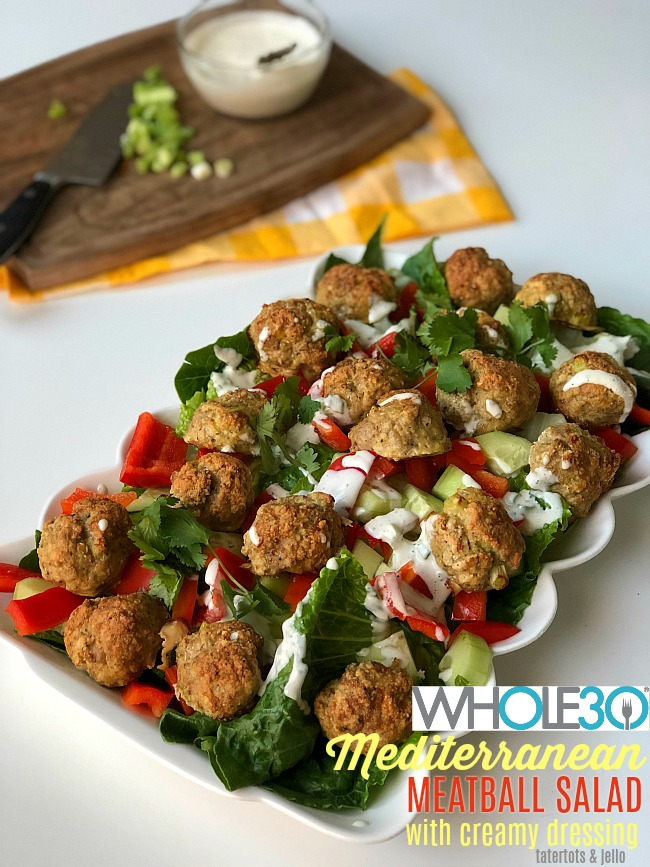 Whole 30 Mediterranean Meatball Salad with Creamy Dressing. Juicy Meatballs with crispy greens and a creamy dressing are delicious and Whole 30 compliant too!