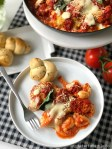 Basil Chicken Gnocchi Skillet Bake. Layers of basil pasta sauce, creamy gnocchi, crisp breaded chicken, fresh basil and gooey cheese are baked for a hearty Italian dish everyone loves! Add buttery garlic knots that you bake in the bag and are perfect for busy families and a and beautiful dish you can serve to your family or to wow visitors!