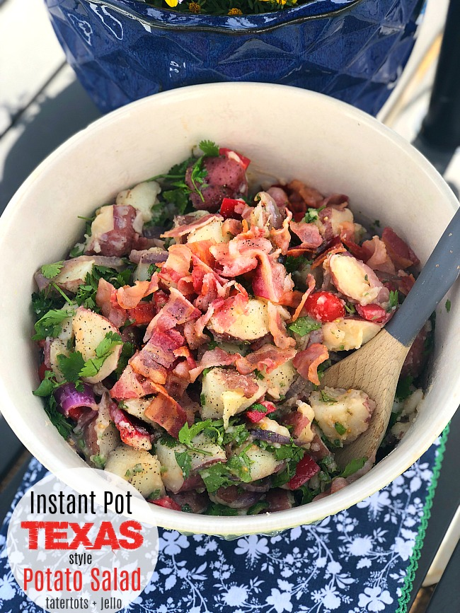 Texas Potato Salad is the perfect dish to take to ANY Summer party or BBQ. Fresh new potatoes in a sweet vingear dressing are tossed with grilled onions and bacon for a light potato salad everyone will love! Make it in your Instant Pot and you can whip this up in just a few minutes.