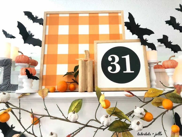 bats flying through an orange orchard halloween mantel