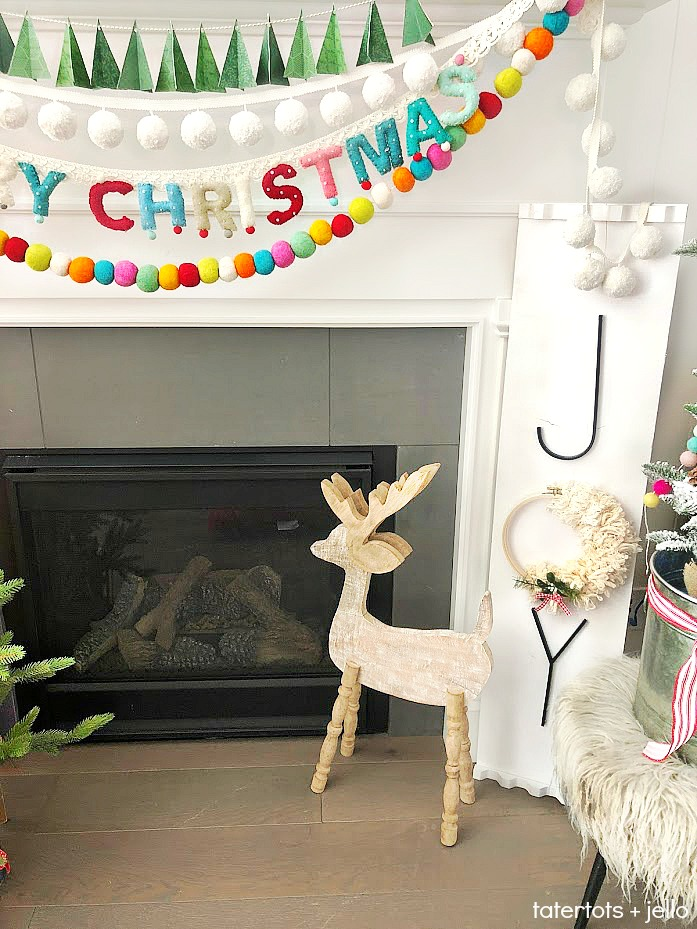 Joy to the world mantel - colorful mantel. Create handmade elements and color for a bright and whimsical mantel this holiday season. Handmade embroidery hoop sayings and giant sign DIY tutorials.