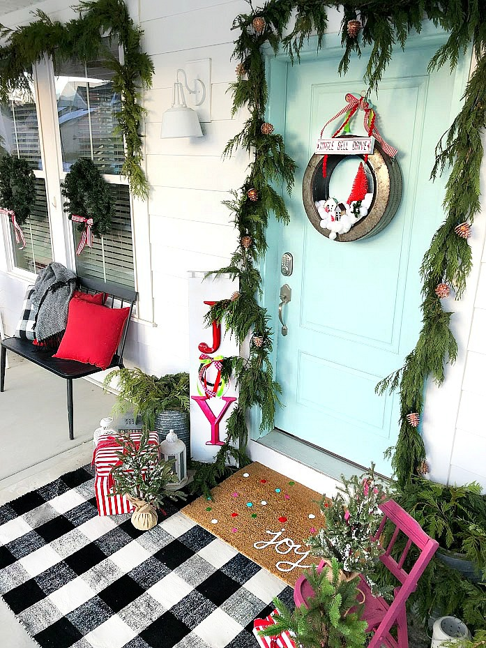 Farmhouse Industrial Snowball Wreath. Make a whimsical snowball wreath with a modern galvanized base, cotton balls, little houses and trees.
