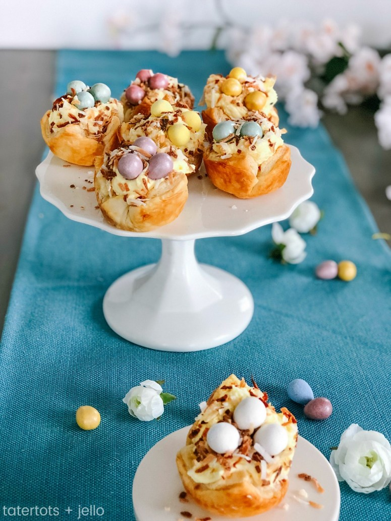 Robin Nests with Whipped Cream Filling - the perfect Spring and Easter treat! Flaky layers of baked puff pastry dough cups cradle creamy, whipped filling topped by toasted coconut and rich chocolate eggs. Bake up a beautiful dessert for Spring and Easter in just minutes!
