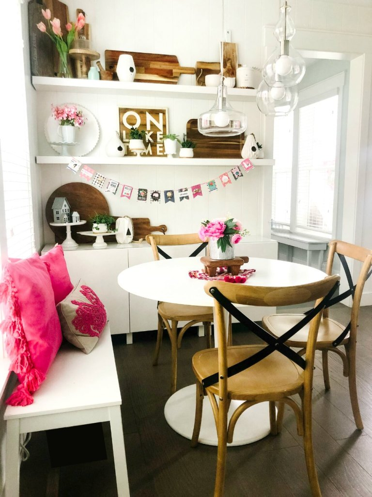 Colorful Summer Farmhouse Kitchen Nook. Turn a corner of your kitchen into a colorful nook with bright summer elements, pillows and a DIY Summer ADVENTURE banner!