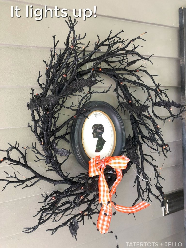 spooky black branch wreath with light up red bat eye lights.