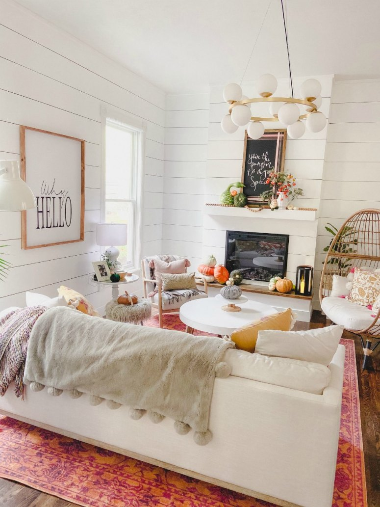 Colorful fall family room and natural pumpkin mantel.