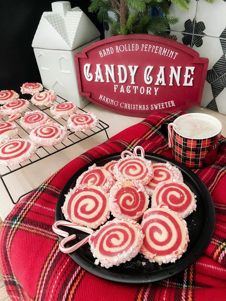 Candy Cane Frosted Swirl Cookies. Take the classic candy cane cookie and give it a modern update by rolling it and frosting it with crushed candy canes!