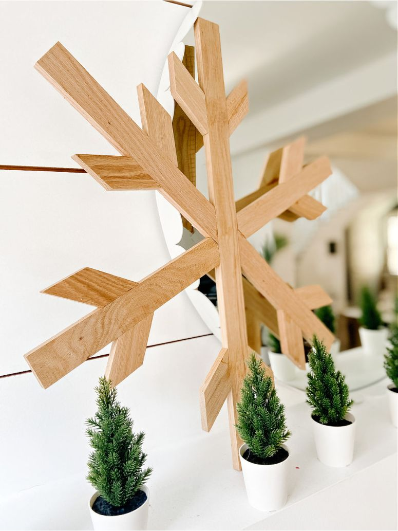 DIY Giant Farmhouse Wood Snowflake. Celebrate Winter by making a gorgeous giant wood snowflake to hang up or place on your mantel!