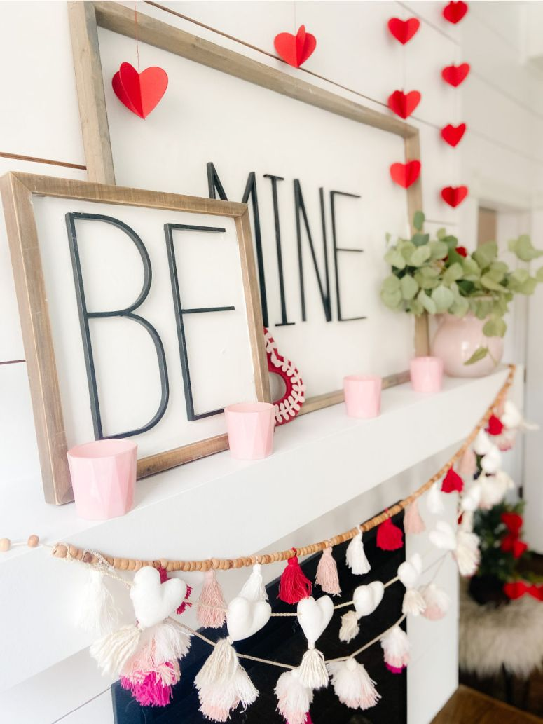 Be Mine Valentine Mantel Ideas. Create some DIY Valentine's signs, hang festive banners two ways and add hearts to a tree for colorful Valentine's Day decor!