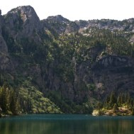 Lake Angeles, with the island in the middle, set against steep rocky cliffs of Klahhane Ridge