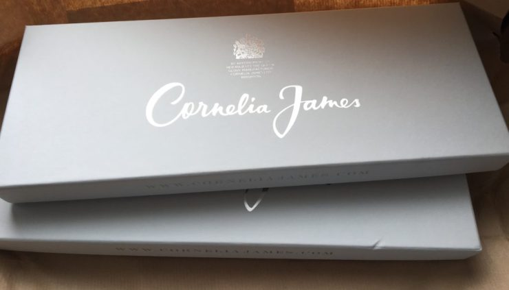The pretty grey boxes that contain pashmina and gloves from Cornelia James