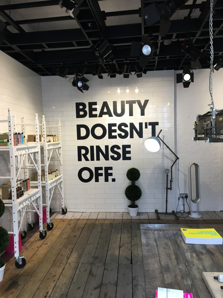 """DECEIM store wall message: """"Beauty doesn't rinse off. """""""