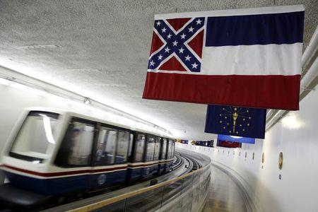 File photo of the  Mississippi state flag, which incorporates the Confederate battle flag, hanging with other state flags in the subway system under the U.S. Capitol in Washington
