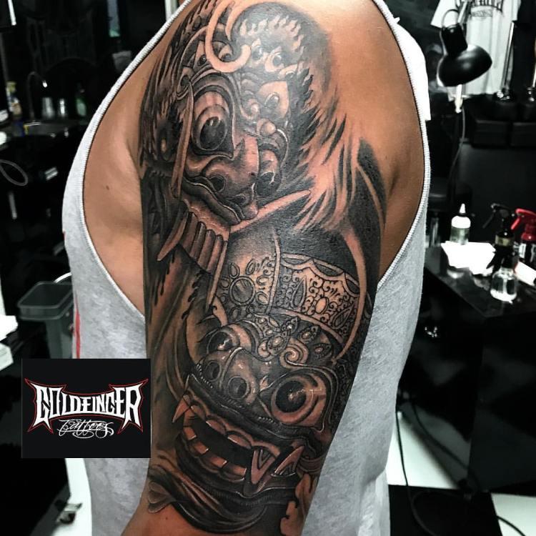 Rangda and Barong Mask Tattoo Sleeve by Gus Badra Goldfinger Tattoo Studio